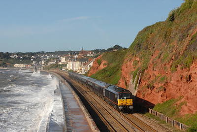 On 11-09-09 HRH Prince of Wales visited Devon to go to the Met Office, Tavistock, Prince Town and Exeter Cathedral. The Royal party came by train and following their visits returned back to London by train. During the day the train had been stabled at Hackney Yard. Here the the Royal Party is seen heading up the sea wall at 0930 on its way to Exeter with a dramatic sea breaking over the sea wall. running as 1Z27