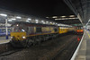 Following the derailment of 66111 the Recovery train was sent from Bescot to Exeter St Davids. The train ran as 2Z99 Bescot - Exeter St Davids. After a few hours in Exeter Riverside the train is seen in platform 3 at Exeter waiting access to the Recovery site