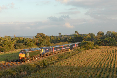 In golden evening light, but only just as it was 1733 after all! 57604 storms passed Matford, on the Exeter By-Pass with 1A91. The loco had been in Exeter for driver training and was therefore in position when 1A91 1400 Penzance - Paddington suffered a failed power car, which necessitated a drag over the South Devon Banks due to Network Rail rules. The power cars on the train are 43063 + 43179