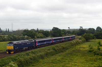 By Exeter the rain had abated 57602 working 2E75 1125 Par ~ Exeter St Davids passes Bridge Road, Matford in Exeter 24/05/14